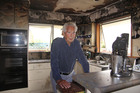 Eric Bell in the fire-damaged kitchen of his home. Photo / Geoff Sloan