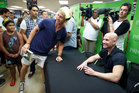 Andre Agassi meets a few of the 1100 fans who attended book signings for his frank autobiography Open at Paper Plus in Newmarket, Auckland (above) and Christchurch. Photo / Richard Robinson