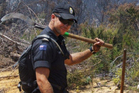 Navy personnel from HMNZS Otago were deployed to help fight the bushfires on Great Barrier Island.