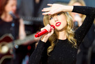 Taylor Swift has revealed the hurt she felt after being the butt of jokes at the Golden Globes and on Saturday Night Live. Photo / AP
