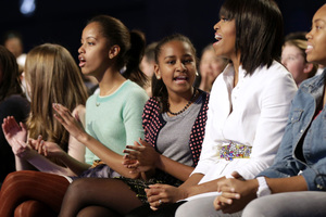 "First lady Michelle Obama and daughters Sasha (centre) and Malia at the ""Our Children, Our Future"" event in Washington at the weekend. Photo / AP"