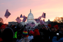 On icy inauguration days Americans see it as their duty to throng Washington's Capitol Hill and wave their Old Glories.  Photo / AP