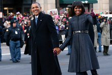 President Barack Obama and first lady Michelle Obama walk down Pennsylvania Avenue in Washington. Photo / AP