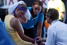 Victoria Azarenka being treated courtside at Melbourne on Thursday. Photo / AP