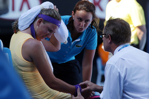 Victoria Azarenka being treated courtside at Melbourne on Thursday. Photo / AP