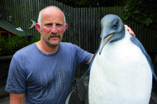 Gareth Morgan takes a shine to a penguin sculpture but thinks cats are serial killers. Photo / APN