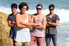 Rescuers Kris Troy, 15, Lucan Battison, 14, Nick Roydhouse, 17, and Daniel Troy, 17, braved a huge swell to save the swimmers at Waipatiki Beach. Photo / Paul Taylor