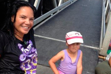 Paulette Lewis with the little girl whose life she saved at Mangonui. Photo / Supplied