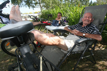 Bill McGavock and his son Steve put their feet up at Clareville camp ground after biking 81 kms from Mangatainoka on their way to Invercargill. Photo / Lynda Feringa