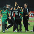 New Zealand's Kyle Mills celebrate with his team mates after taking the wicket of David Miler of South Africa. Photo / AP