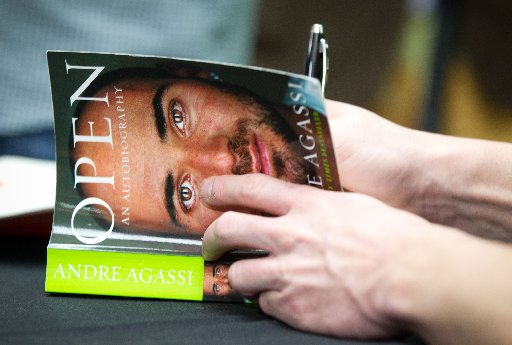 Tennis great Andre Agassi signs copies of his autobiography Open at at Paper Plus in Newmarket, Auckland.