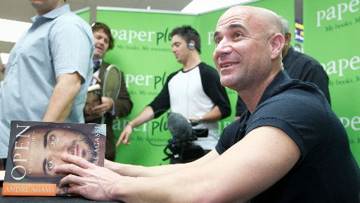 Fans queue for tennis great Andre Agassi signing copies of his autobiography, entitled Open, at Paper Plus in Newmarket, Auckland.