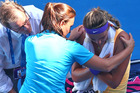 Medical staff attend to Victoria Azarenka in her semifinal match against Sloane Stephens. Photo /Getty Images