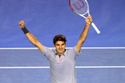 Roger Federer celebrates winning his Quarterfinal match against Jo-Wilfred Tsonga . Photo / Getty Images