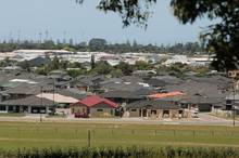 John Key has warned local councils - particularly Auckland - that they must start opening up land for housing development, or central government will step in. Photo / File