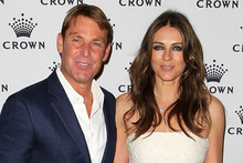 Elizabeth Hurley with her fiancée Shane Warne. The pair plan to get married this year.Photo / AFP
