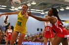 Sasha Corbin of England challenges for possession with Australia's Rebecca Bulley. Photo / Getty Images