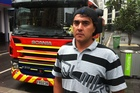 Jamie Whittaker escaped a burning apartment building in Auckland this morning. Photo / Matthew Theunissen