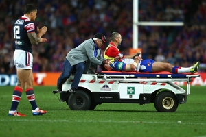 Sonny Bill Williams claps off Danny Buderus of the Knights as he is taken from the ground. Photo / Getty Images