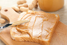 Eating peanut butter twice each week reduces breast cancer risk by 39 per cent. Photo / Thinkstock
