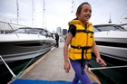Anneliese Parsons, 8, from Bucklands Beach in her new lifejacket at the Auckland boat show. Photo / Dean Purcell