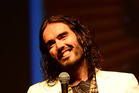 Russell Brand locked lips with many fans in his audience in Georgia. Photo / Getty Images