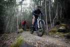 Michael mountain bikes down Mt Wellington and up to MONA with guide Rob Potter. Photo / Christine Cornege
