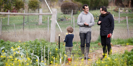 Chef and owner Rodney Dunn and son Tristan talk to Michael in the vege patch. Photo / Christine Cornege
