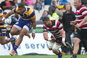 Steamers winger Tino Nemani skips out of a weak tackle from a Counties Manukau player.