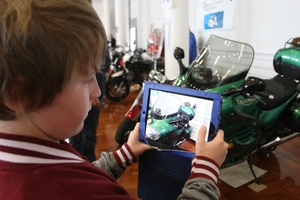 Jacob Robinson, 12, videos Baz Shipp's 2003 Triumph Trophy 1200 motorcycle with his iPad.  PHOTO/ BEVAN CONLEY 280913WCBRCMOT03