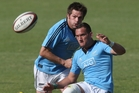 Aaron Cruden and Richie McCaw take part in an All Blacks training session in Johannesburg yesterday. Photo / Getty Images