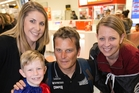 Team NZ skipper Dean Barker with Tracy Scans, Harry Wurr and Nicky Wurr at the airport. Photo / Greg Bowker