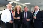 OPEN FOR BUSINESS: Enjoying the official opening of the new Bayleys Real Estate office in Whangarei are, from left, area manager Tony Grindle, franchise owner Kirsten Stevenson, Bayleys executive chairman John Bayley, and franchise owner Mark Macky. PHOTO/JOHN STONE