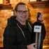 Michael poses with a 6 litre bottle of Church Block wine. Photo / Christine Cornege