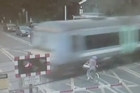 Footage released by the British Transport Police shows a cyclist come within a whisker of being struck by a train after passing the security barrier at a crossing in Waterbeach, in the English county of Cambridgeshire.