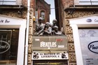 Bronze likenesses of the mop-haired Fab Four surmount The Beatles Shop. Photo / Paul Rush
