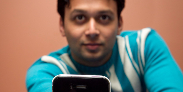 Nameet Patil has bought a new smartphone after he found his old Android one was hacked. Photo / Natalie Slade Photo / Natalie Slade