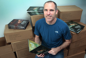James Russell published his own children's book, The Dragon Hunters. Photo / Doug Sherring