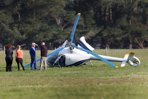 The Guimbal Cabri helicopter crashed in a paddock north of the Waimakariri River near Christchurch yesterday. Photo / Mark Mitchell