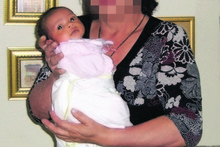 Mohammed Fouad's then-wife holding Salwa as a baby.
