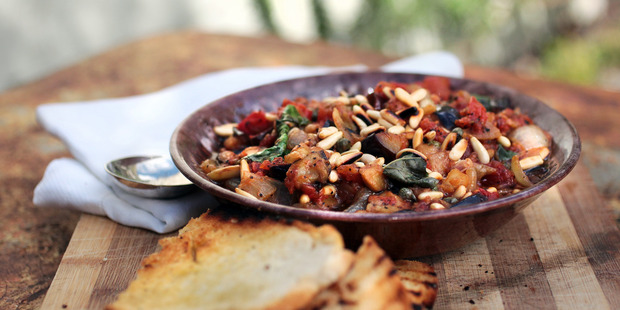 Toasted pine nuts and basil are the finishing touches for Grant's Caponata. Photo / Doug Sherring