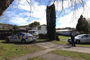 Armed police outside a Kawerau property during the events of September 13. Photo / Rotorua Daily Post