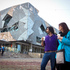 Colin and tour guide Samantha Caffin from Tourism Victoria in Federation Square. Photo / Natalie Slade