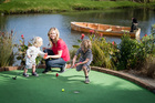 Rachel Grunwell plays mini golf with her sons Finn (L) and Lachlan at Treasure Island. Photo / Michael Craig