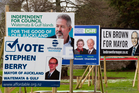 Mayoral billboards vie with ads for other local body candidates around the streets of Auckland. Photo / Richard Robinson