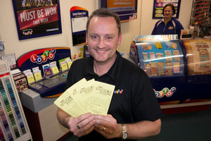 Gary Ashton, owner of One Step Ahead, the shop in Three Lamps, Ponsonby which sold the winning $33 million Lotto Powerball ticket. Photo /  Herald on Sunday / Steven McNicholl
