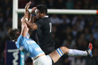 Juan Martin Fernandez Lobbe is challenged by Julian Savea in the match at La Plata yesterday. Photo / Getty Images