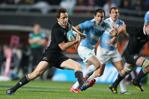 Ben Smith breaks clear to score the All Blacks' third try against Argentina yesterday. Photo / Getty Images