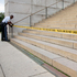 A US Park Police officer ties police tape to a hand rail closing access to the Lincoln Memorial in Washington. Photo / AP