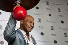 Former heavyweight champion turned boxing promoter Mike Tyson has been signing amateur boxers. Photo / AP